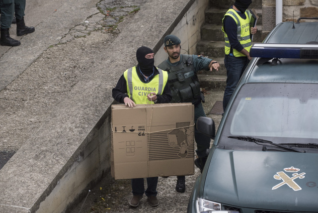 Basque separatists ETA says arrests last week threaten decommissioning of weapons