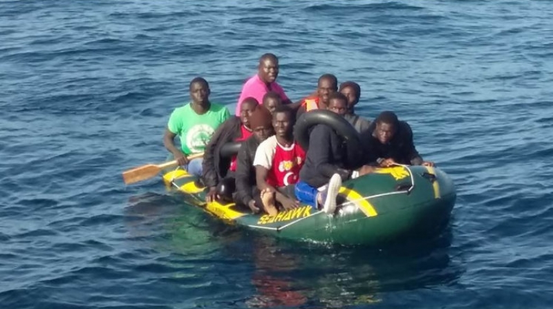 Cadiz authorities rescue immigrants from tiny dinghies and a surfboard
