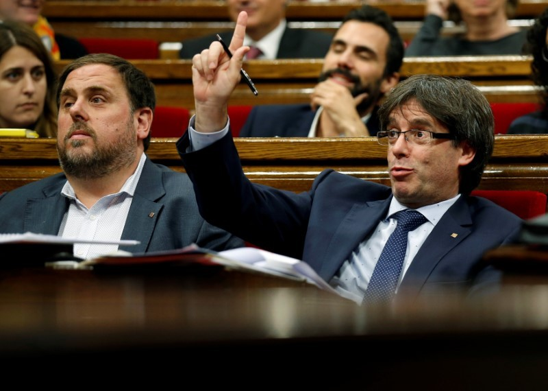 Catalan parliament agrees to pursue independence referendum