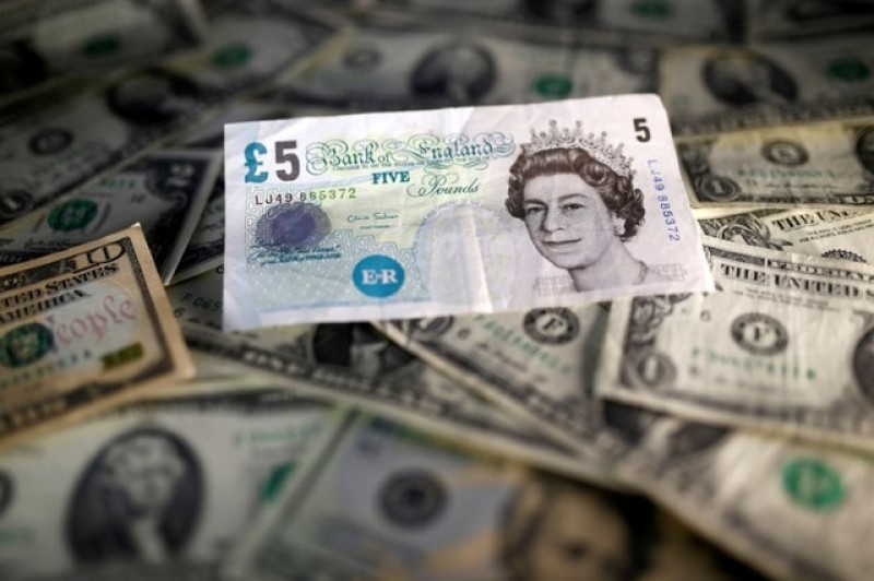 Sterling slides after PM May reignites 'hard Brexit' fears