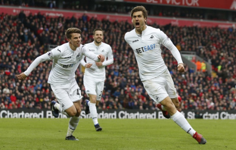 Liverpool title challenge dented by Swansea sensation