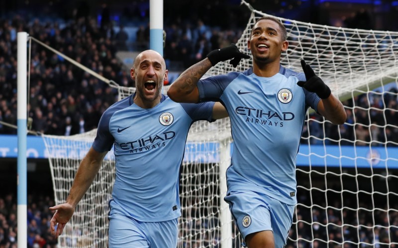 Jesus double lifts City to third with late 2-1 Swansea win