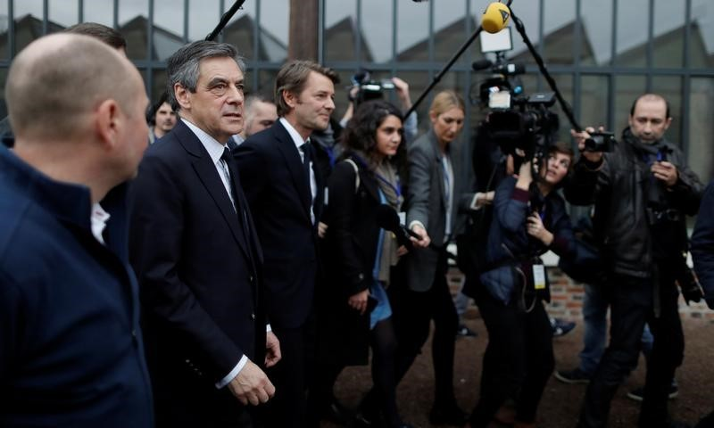 France's Fillon makes appeal to voters, retains party backing
