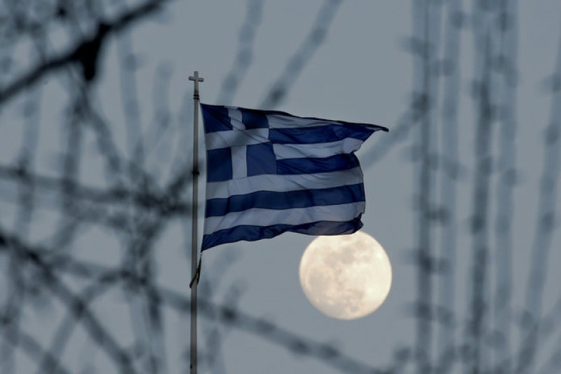 Germany wants Greece in euro zone, EU Commission sends top official to Athens