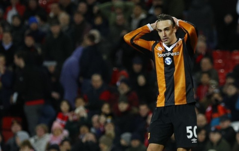 Hull charged with failing to control players at Arsenal