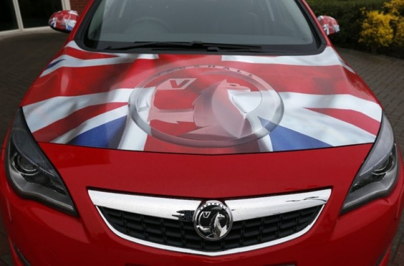 UK raises alarm over threat to Vauxhall from GM-Peugeot deal