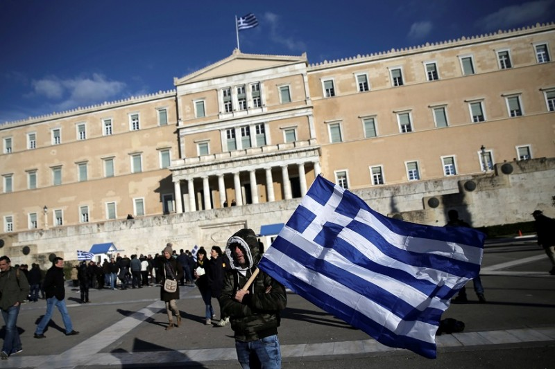 Greece says 'not a euro more' in cuts as EU officials call for speedy deal