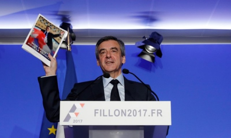 Fillon's campaign relaunch stymied by gifts of luxury suits