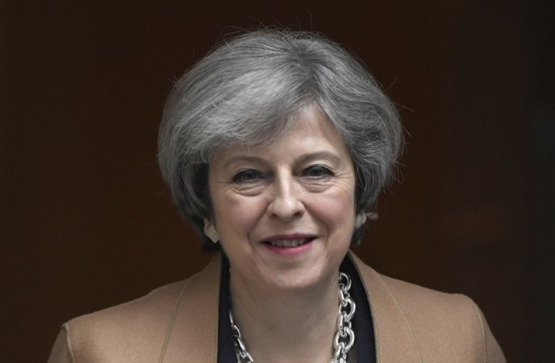 After EU headscarf ruling, May says government should not tell women what to wear
