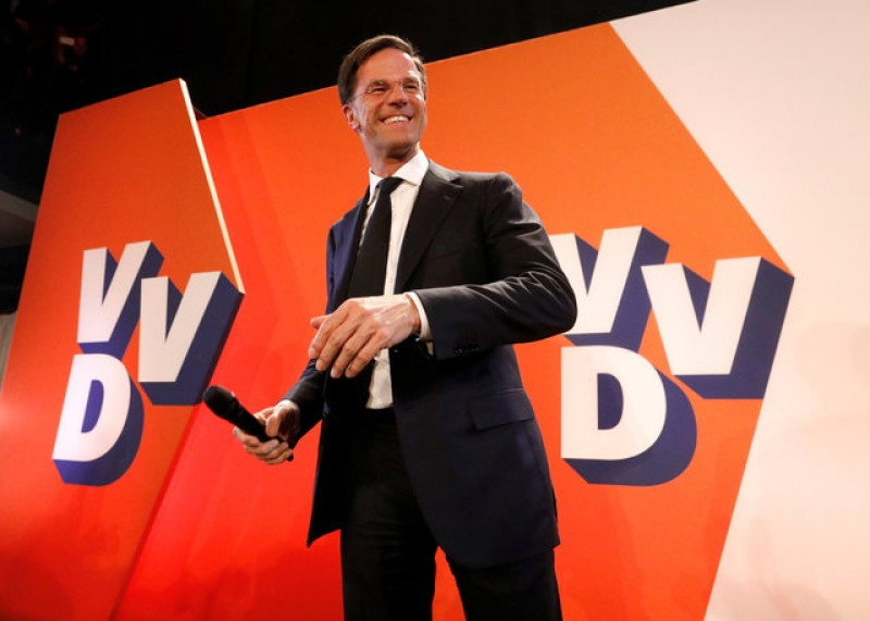 Dutch PM Rutte fends off far-right's Wilders