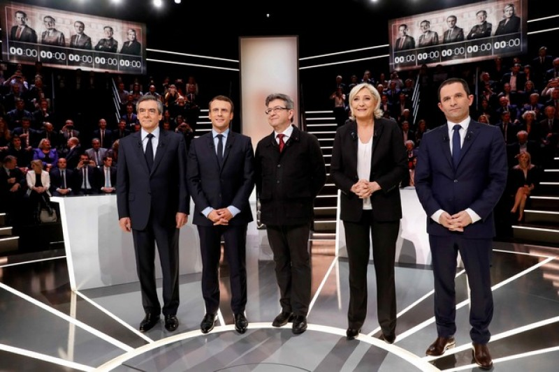 Macron seen winning French TV debate, clashes with Le Pen