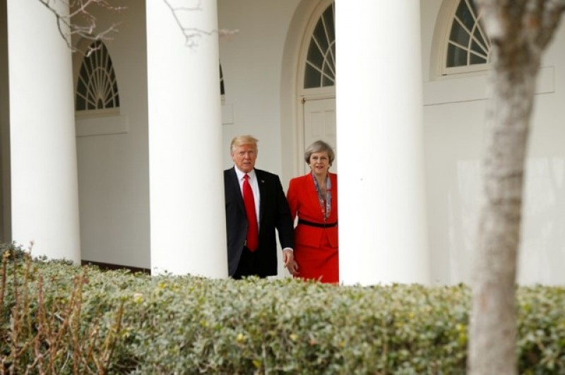 Trump was being a gentleman, May says on holding hands