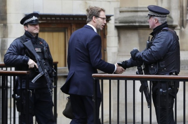 Minister who tried to save policeman greets armed officer
