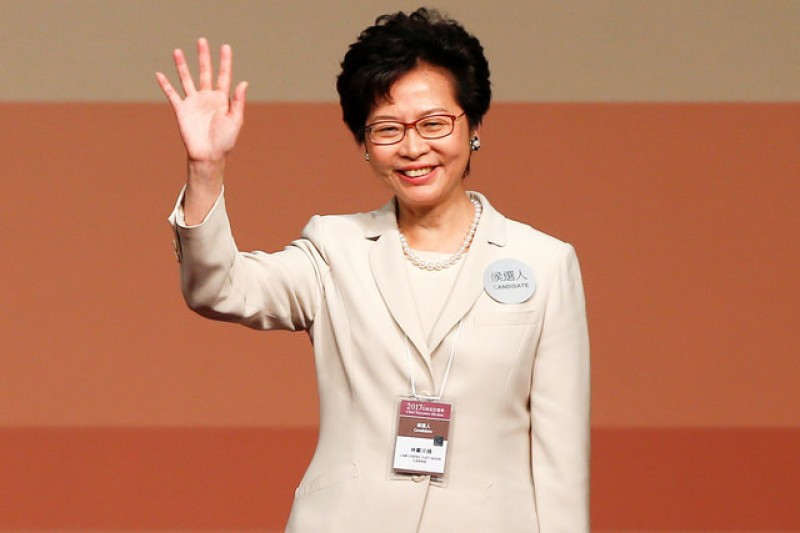 Hong Kong leader-elect pledges smooth transfer of power amid divisions