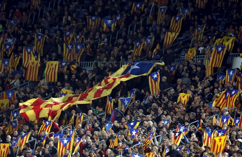 Catalan separatists flaunt flags at football match